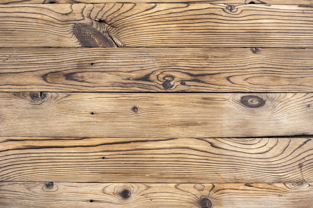 brown wooden plank in close up photography