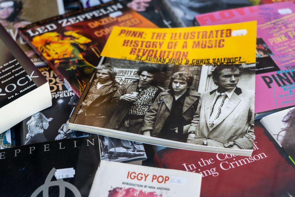 Lots of books related to music, including one in the centre about the Punk Rock revolution.