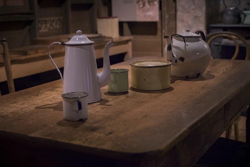 white ceramic teapot on table