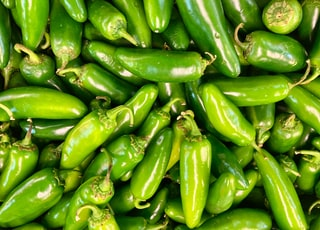 green chili peppers in close up photography