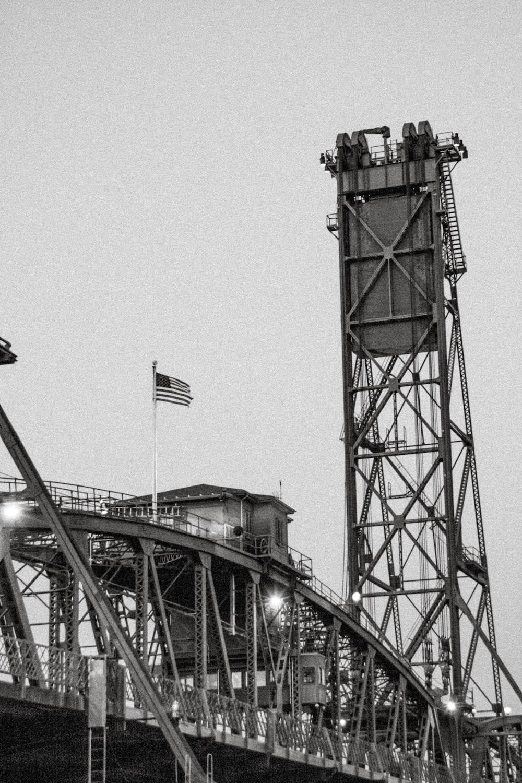 brown metal tower under gray sky