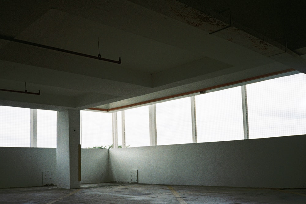white concrete wall with glass window