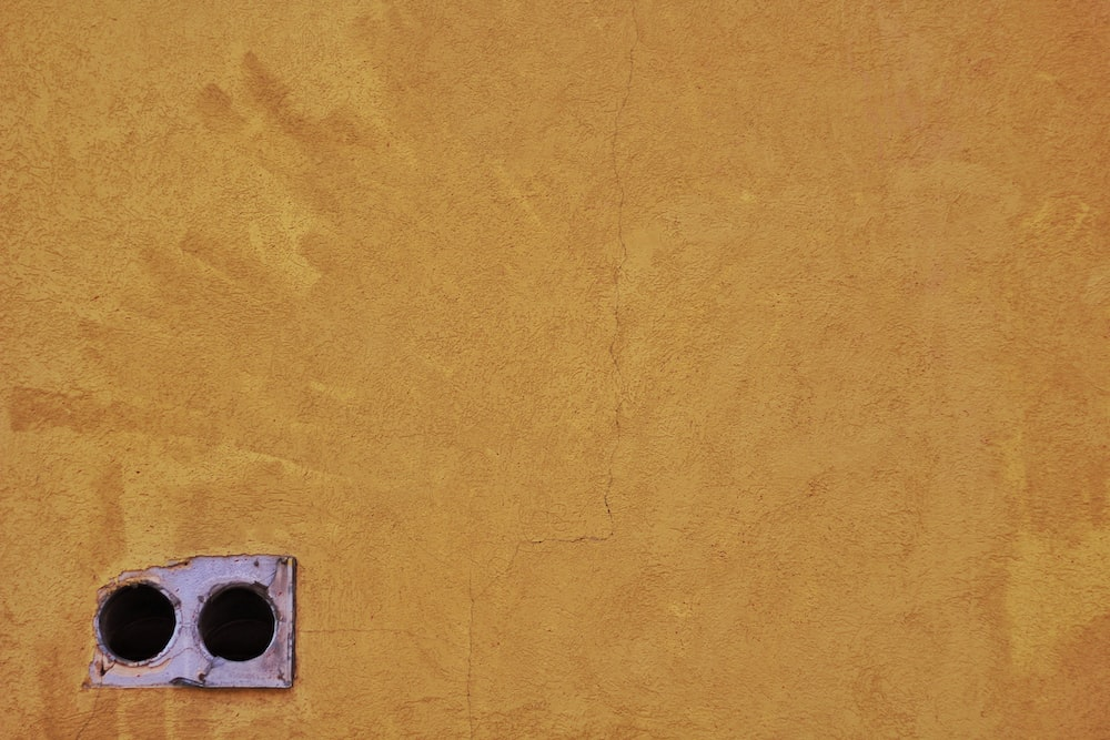 brown concrete wall with hole