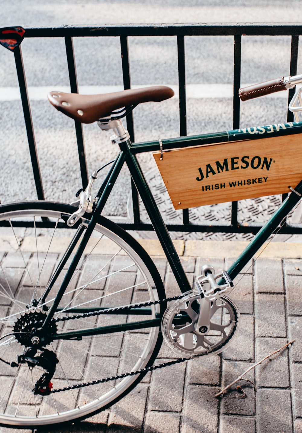black bicycle with brown wooden board