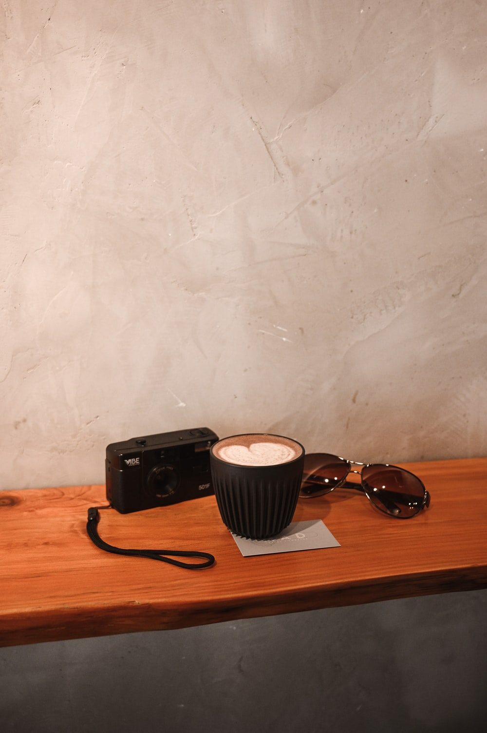 black sunglasses on brown wooden table