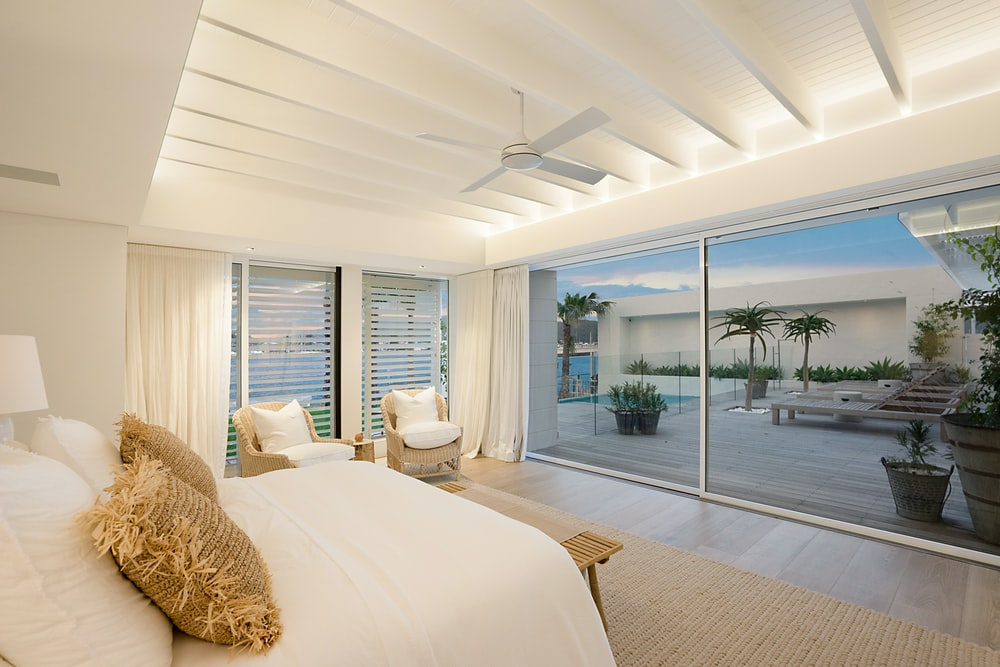 white bed near white wall