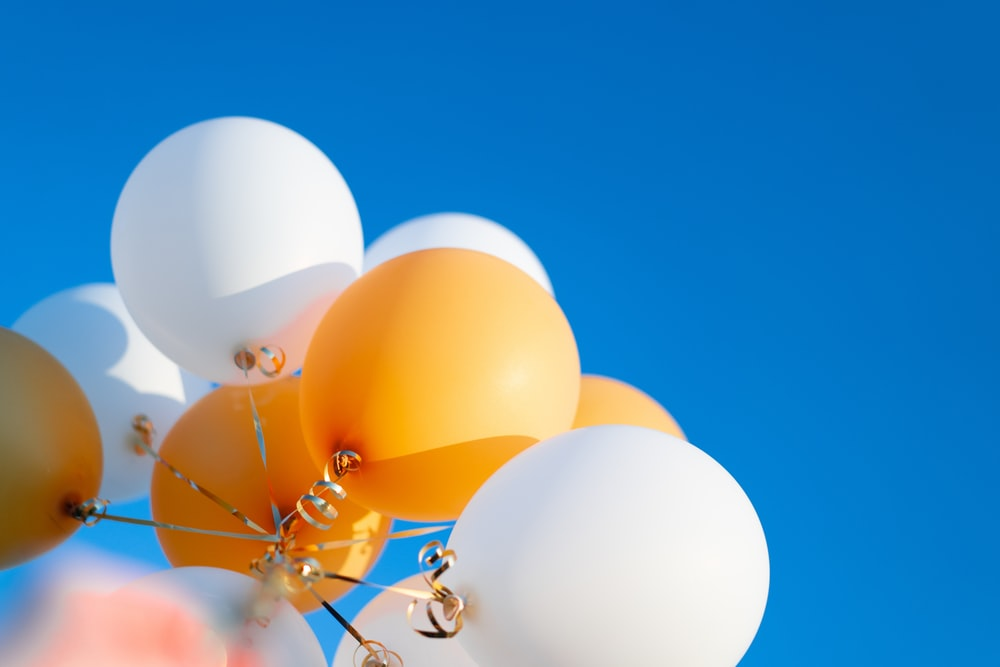 white blue and yellow balloons