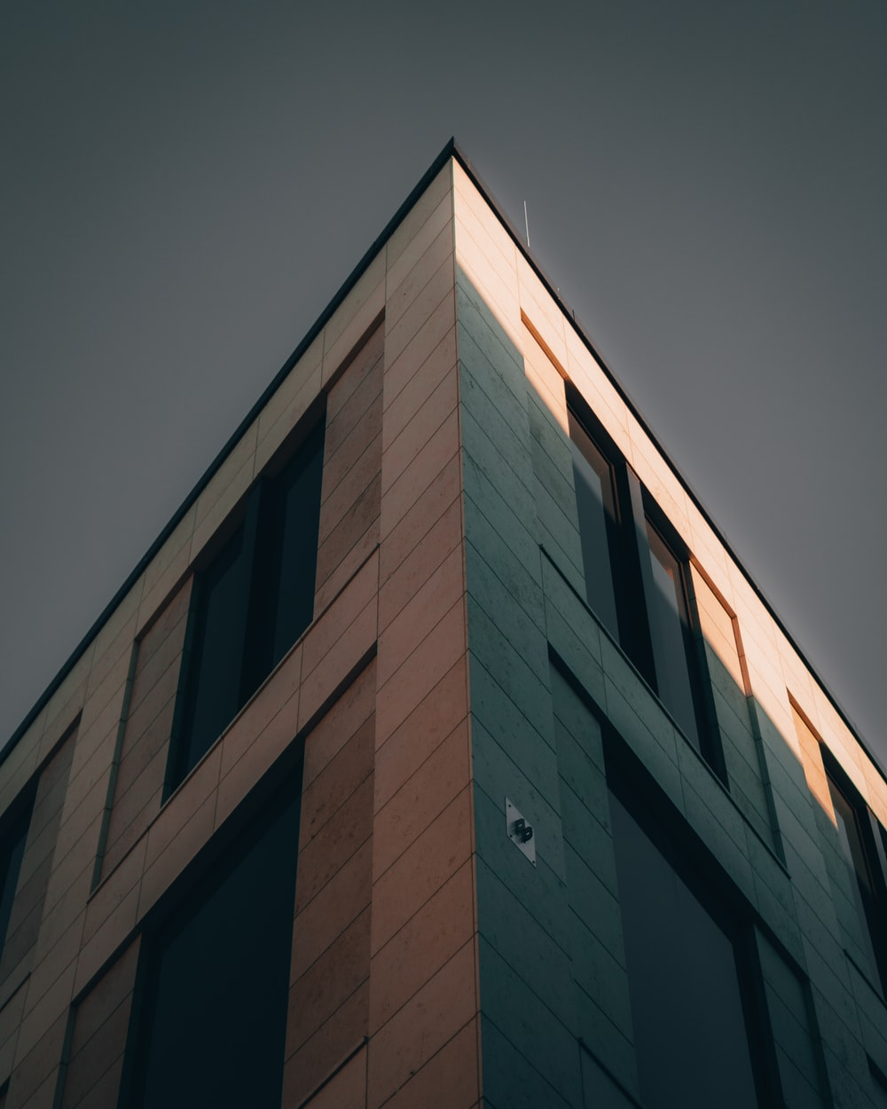 brown concrete building under gray sky