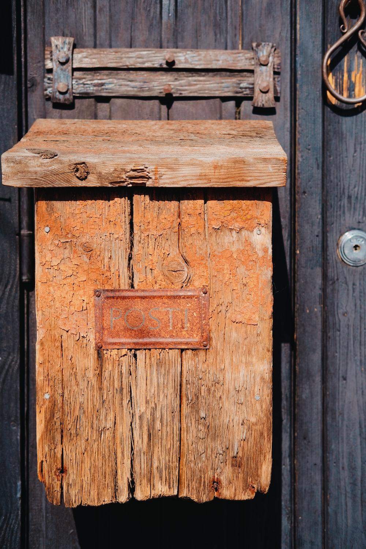 brown wooden door with black steel door knob