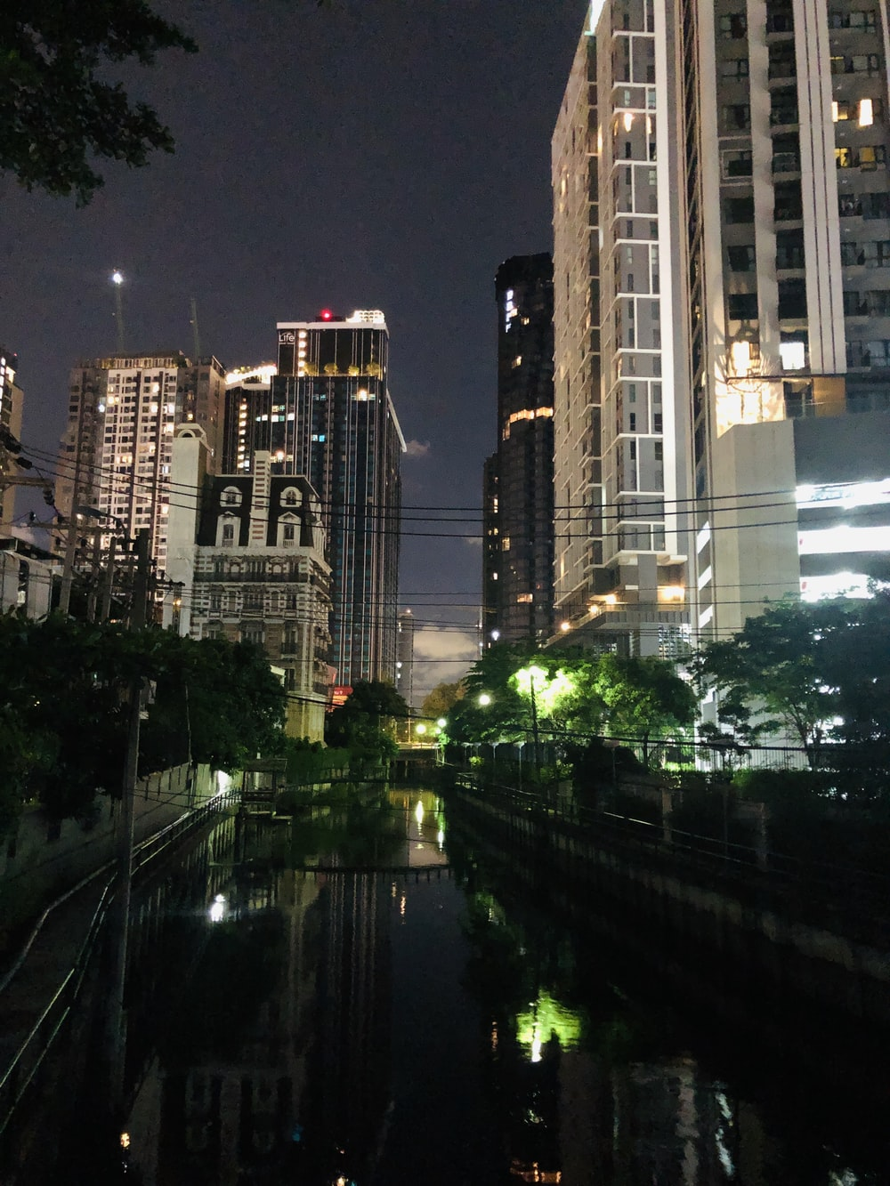 high rise building near river during night time
