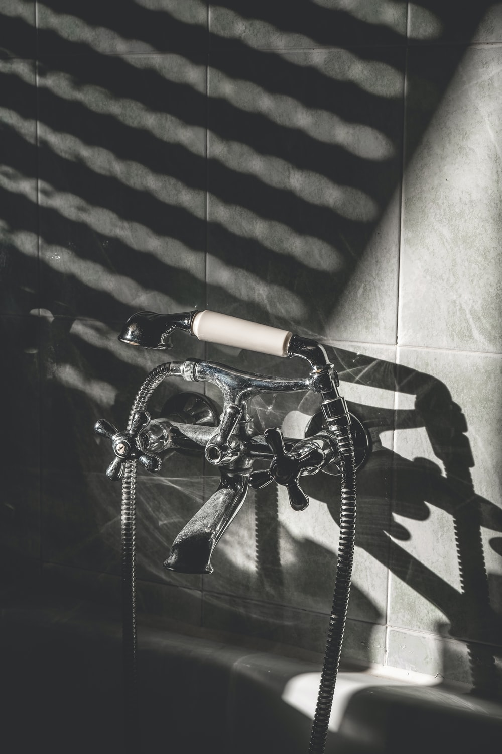black bicycle on black and white wall