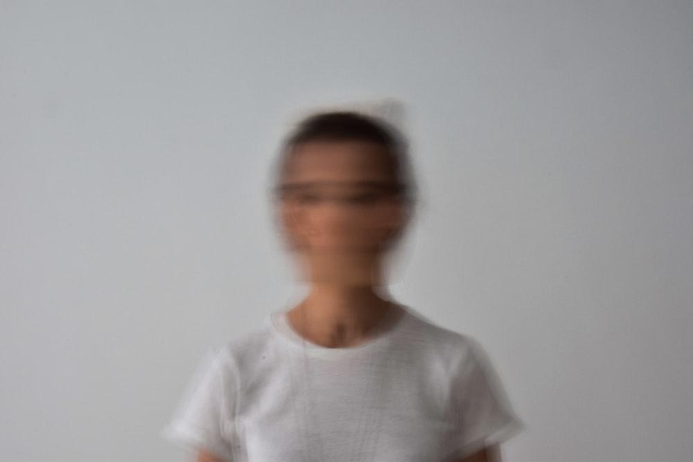 man in white crew neck t-shirt wearing eyeglasses