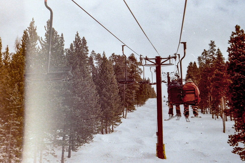 red cable car over snow covered ground