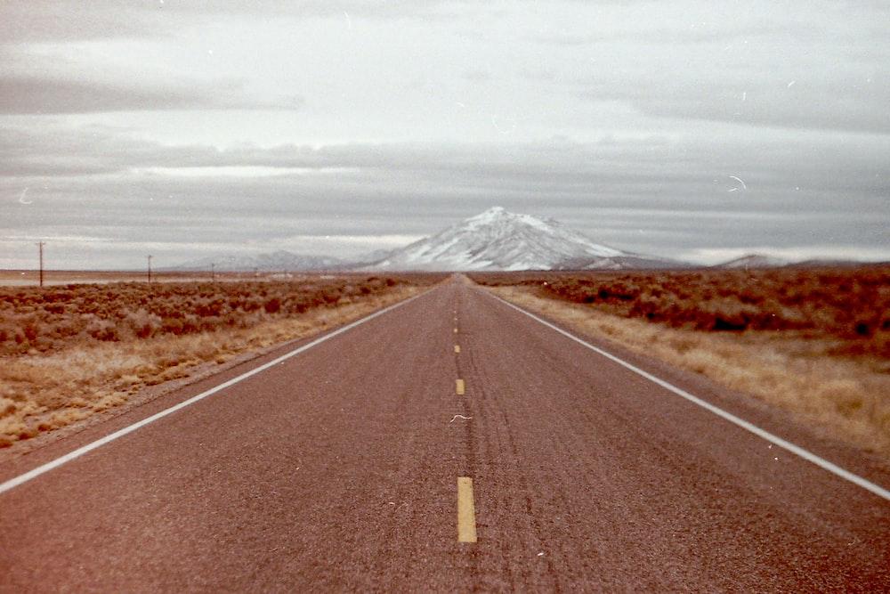 gray asphalt road under white sky during daytime