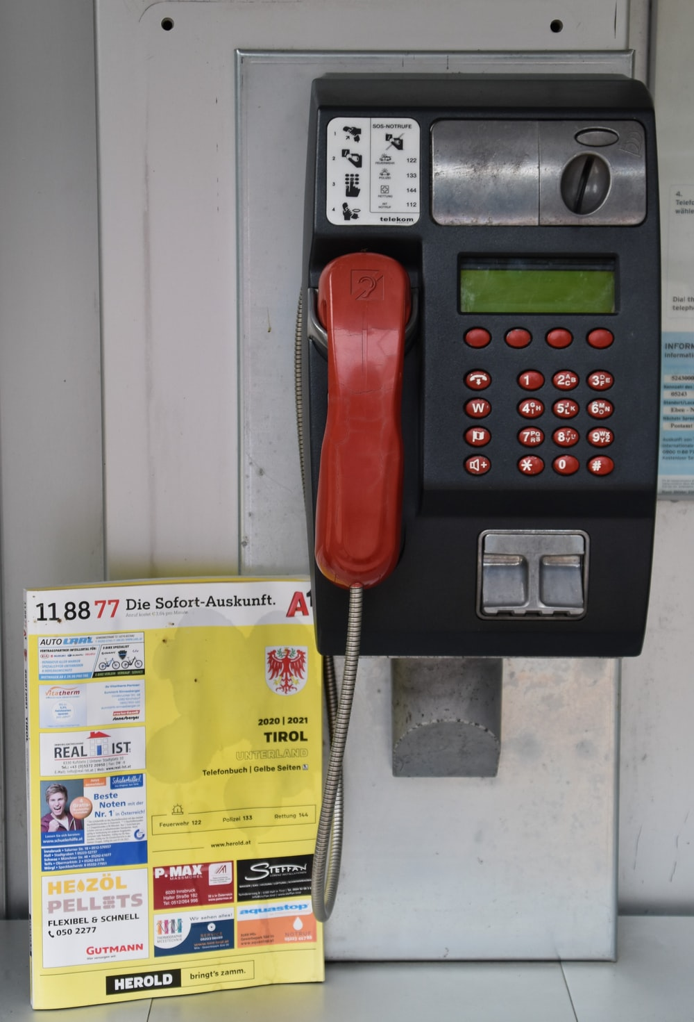 red telephone on yellow paper