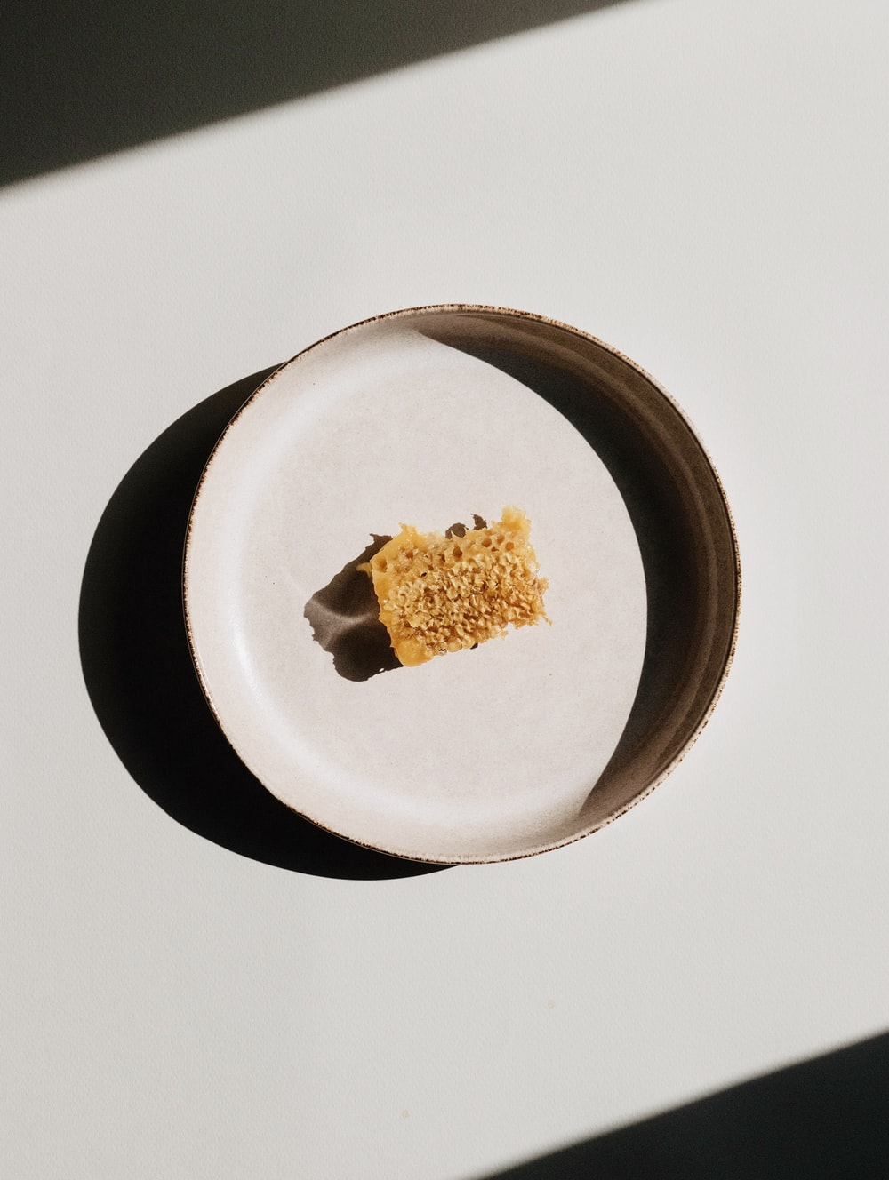brown food on white and black ceramic plate