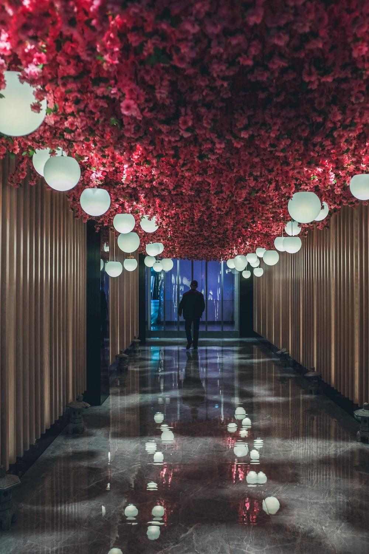 woman in black dress walking on hallway