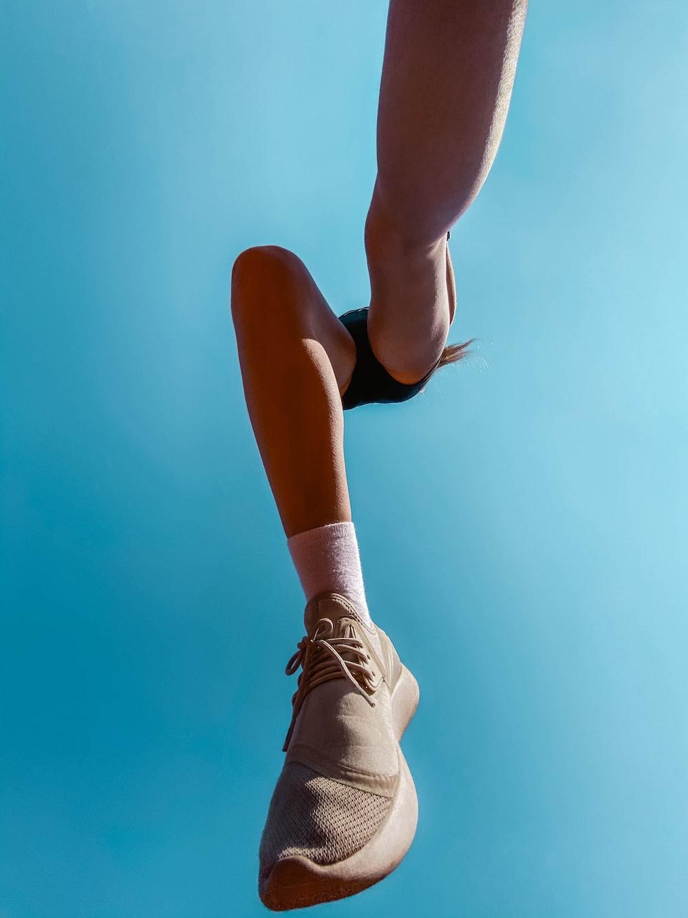 woman in brown low top sneakers