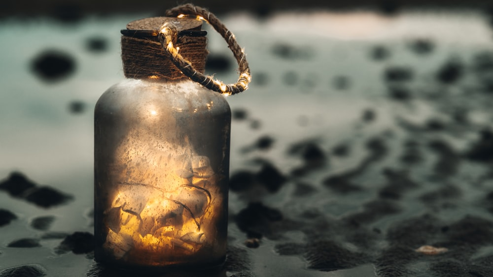 clear glass jar with brown rope