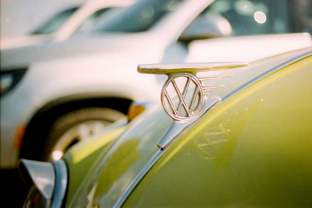 gold car side mirror on green car