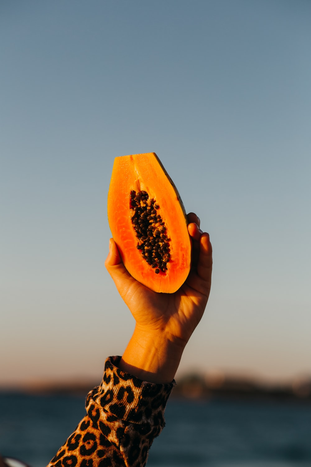 person holding sliced watermelon fruit