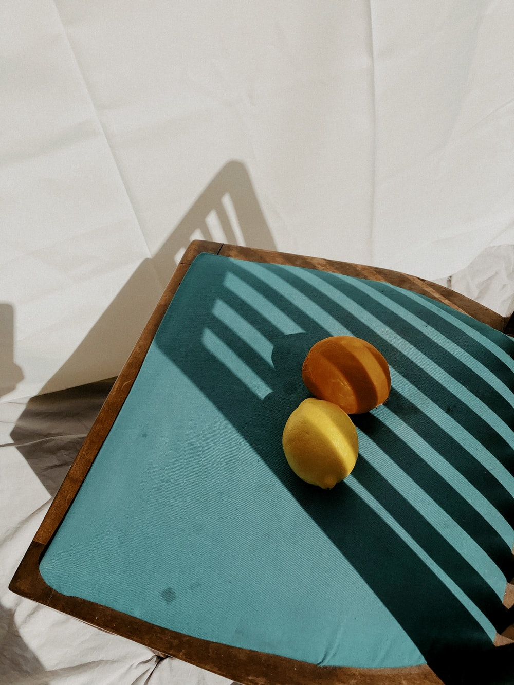 yellow round fruit on blue and white striped textile
