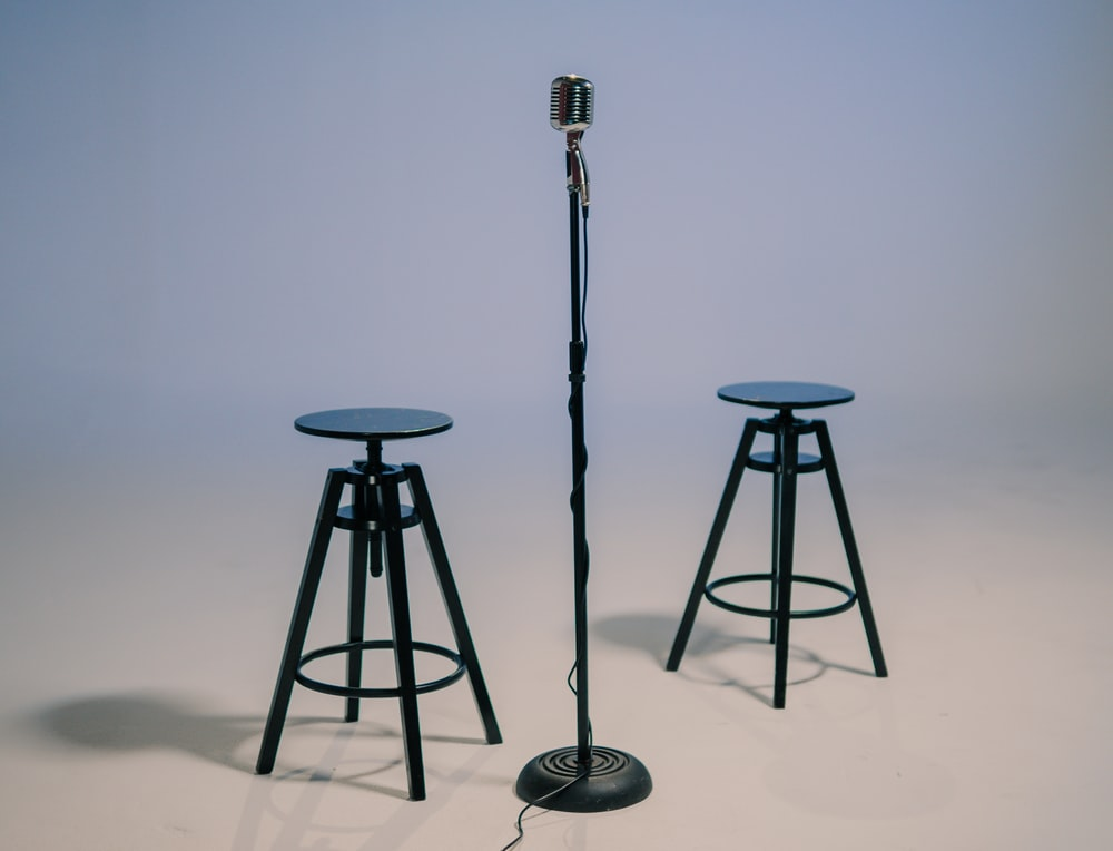 black and gray tripod stand
