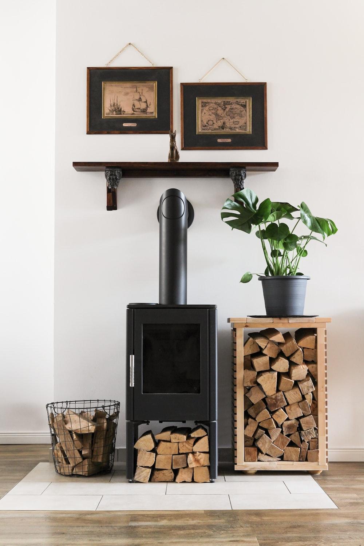 black fireplace beside brown woven basket