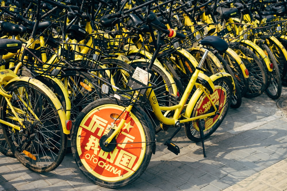 yellow and black bicycle on gray concrete floor