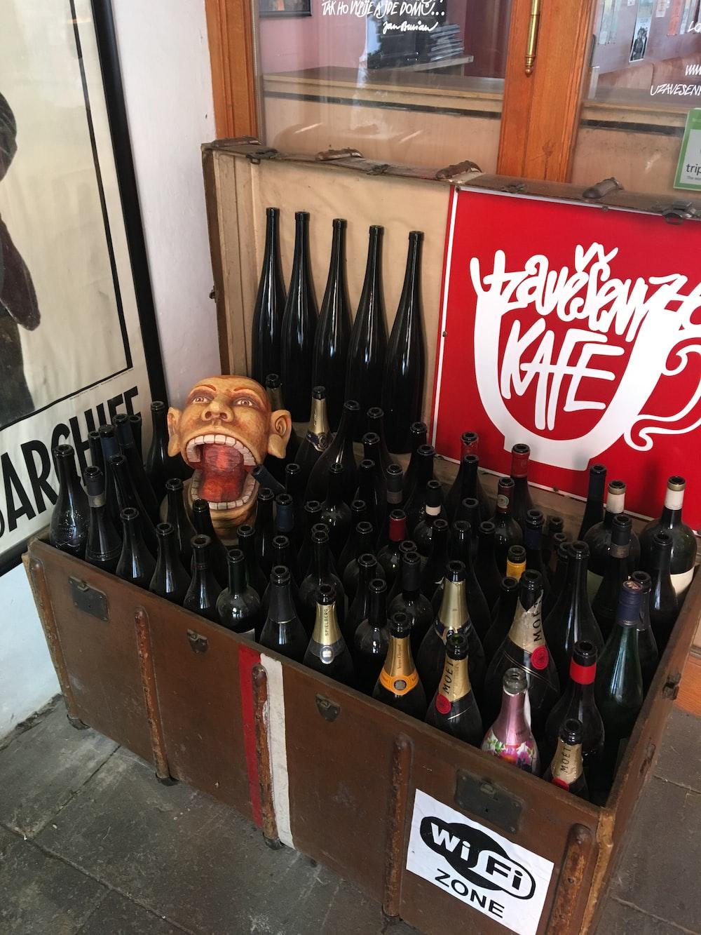 coca cola bottles on brown wooden crate