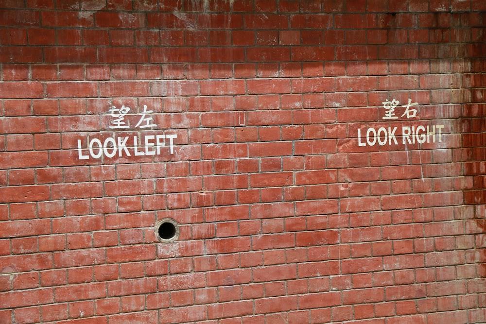 brown brick wall with no smoking sign