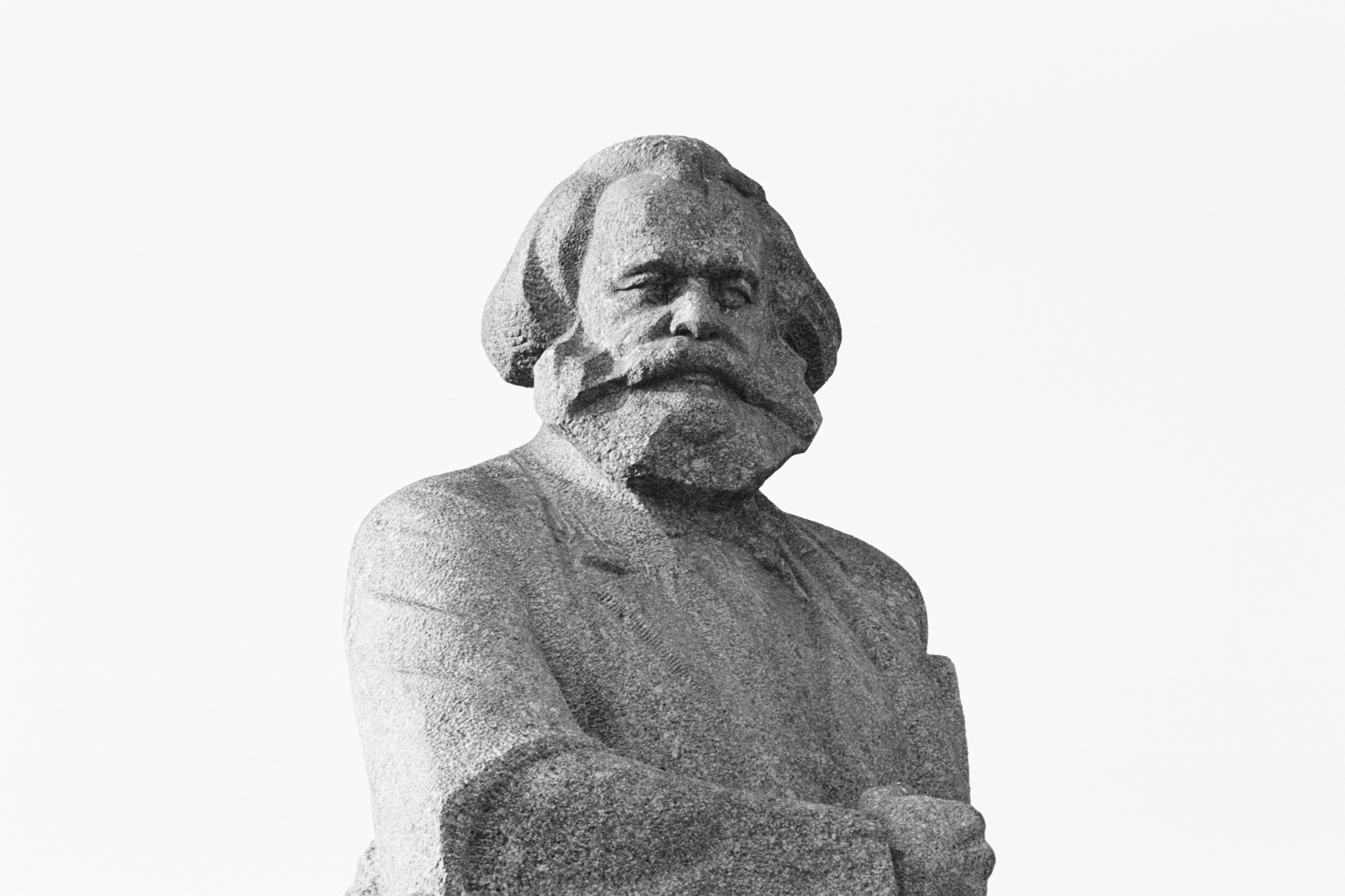 gray scale photo of man statue