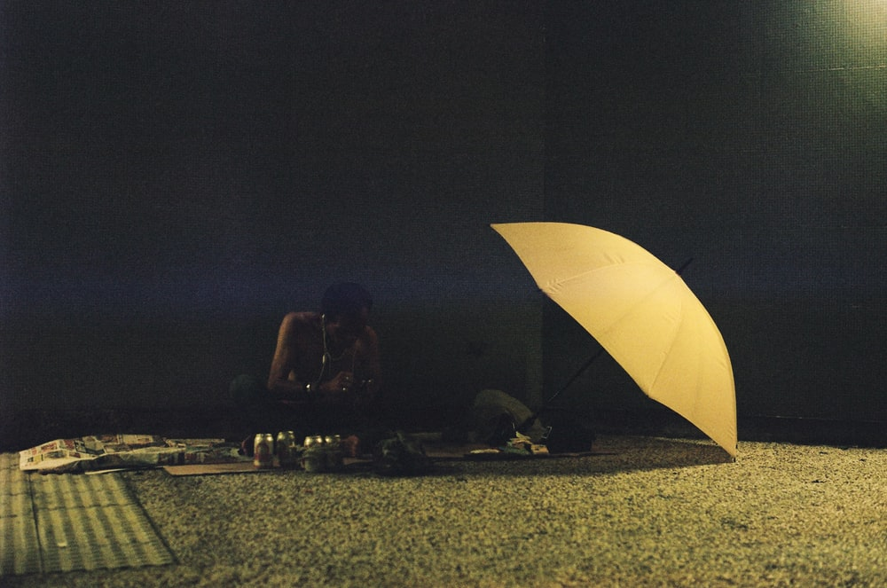 people sitting on the ground during night time