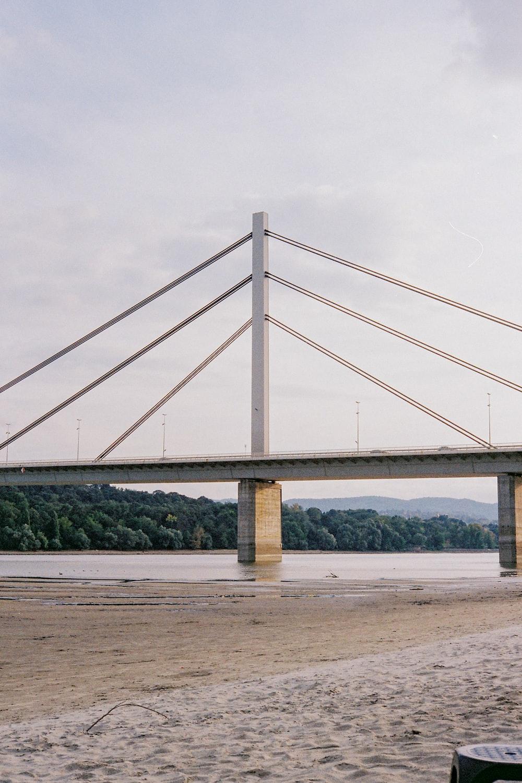white bridge under white sky during daytime