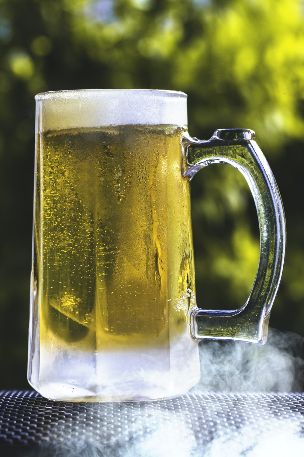 clear glass beer mug with beer
