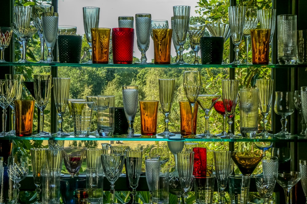 clear drinking glasses on glass shelf