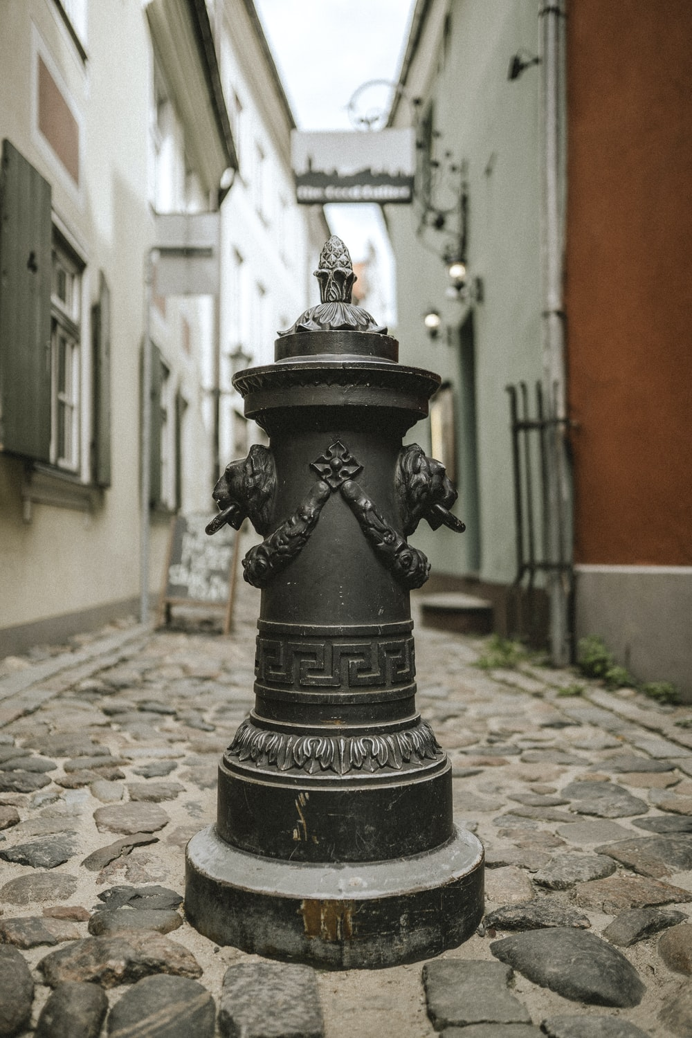 black concrete outdoor fountain in the middle of the street