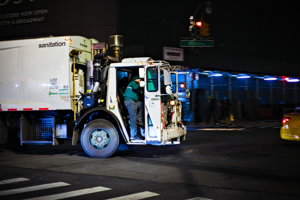 white and blue truck on road during nighttime