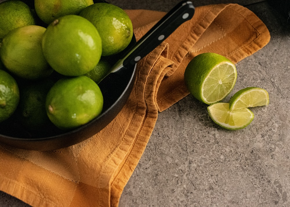 green apple fruit on brown wooden chopping board