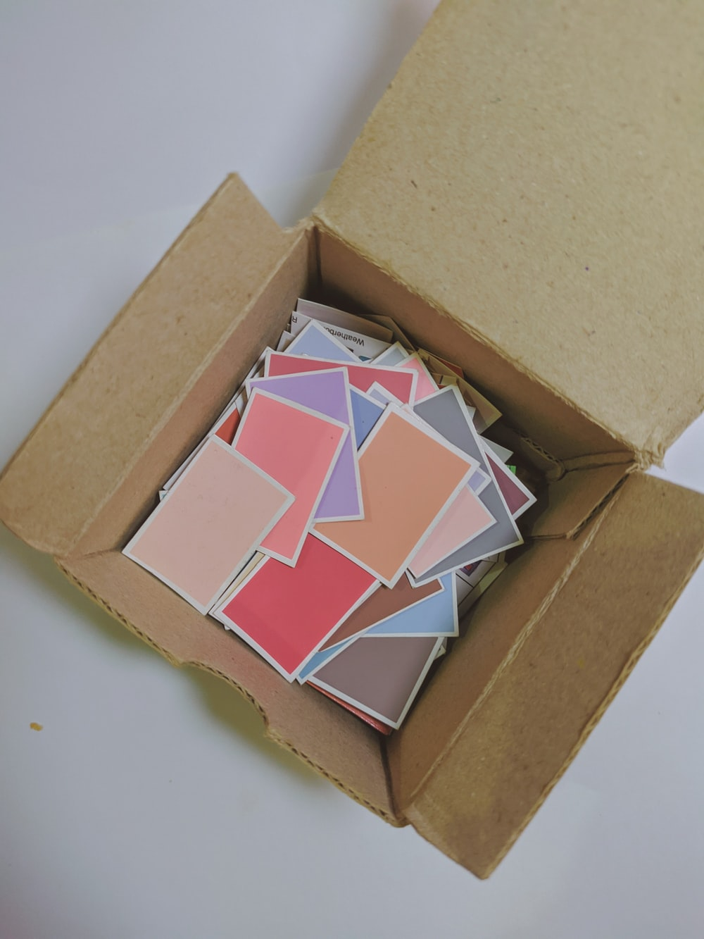brown cardboard box on white surface