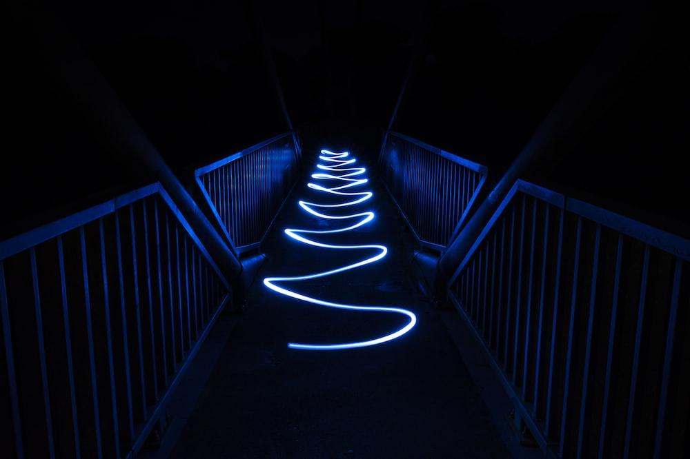 white light on black staircase