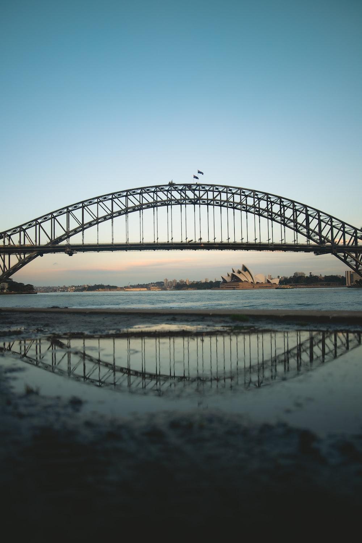 black metal bridge over the sea during daytime
