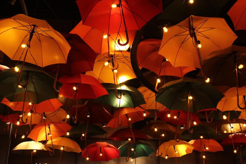 orange umbrellas in the dark