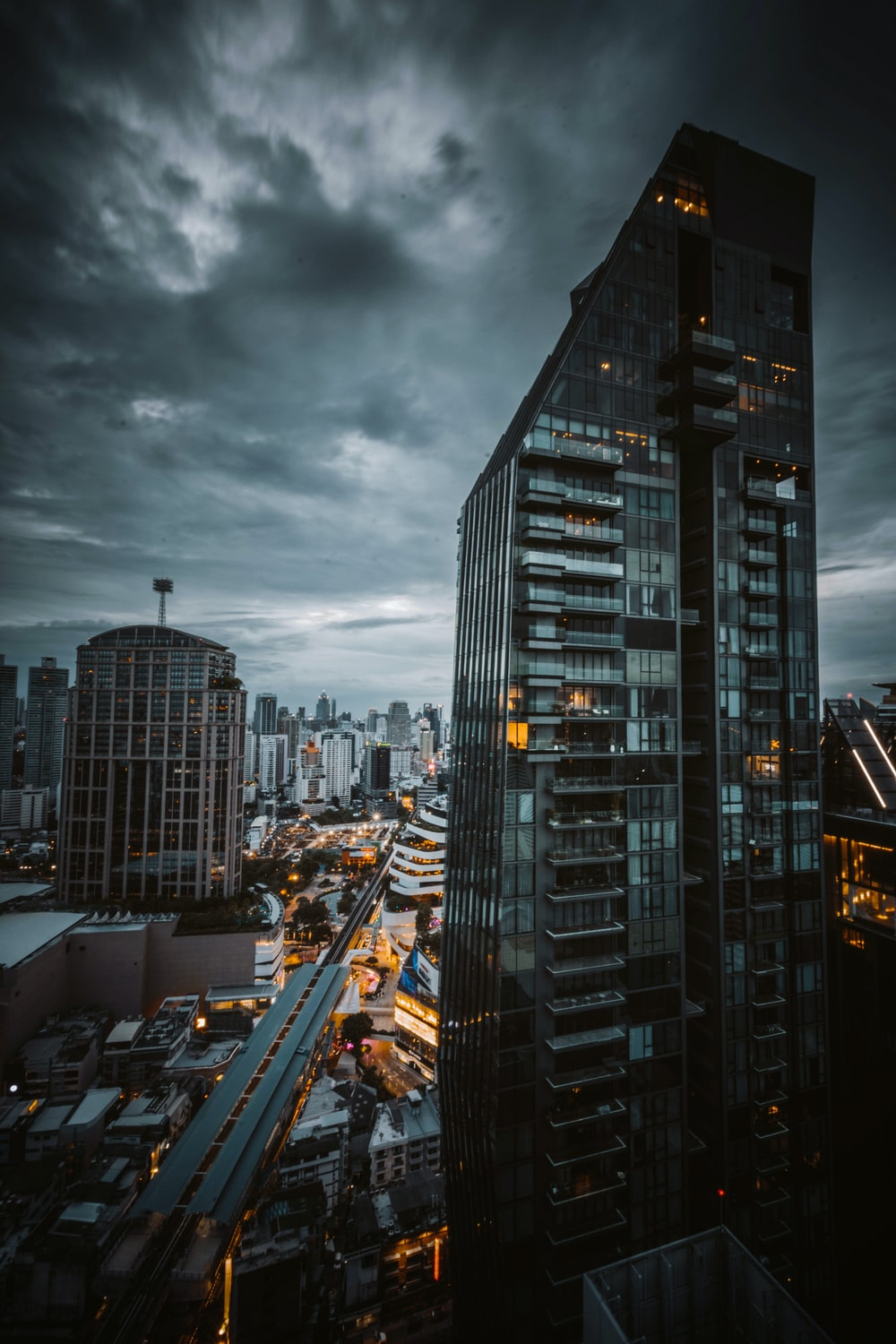 city buildings under gray cloudy sky during daytime