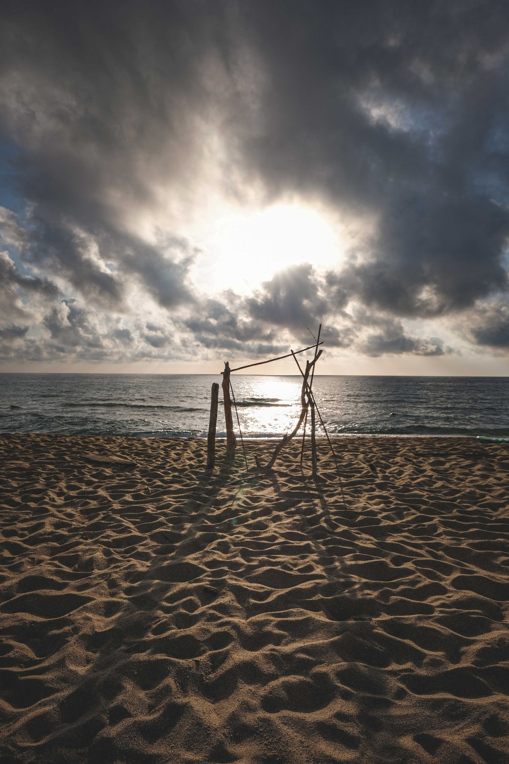 brown wooden swing on beach during daytime