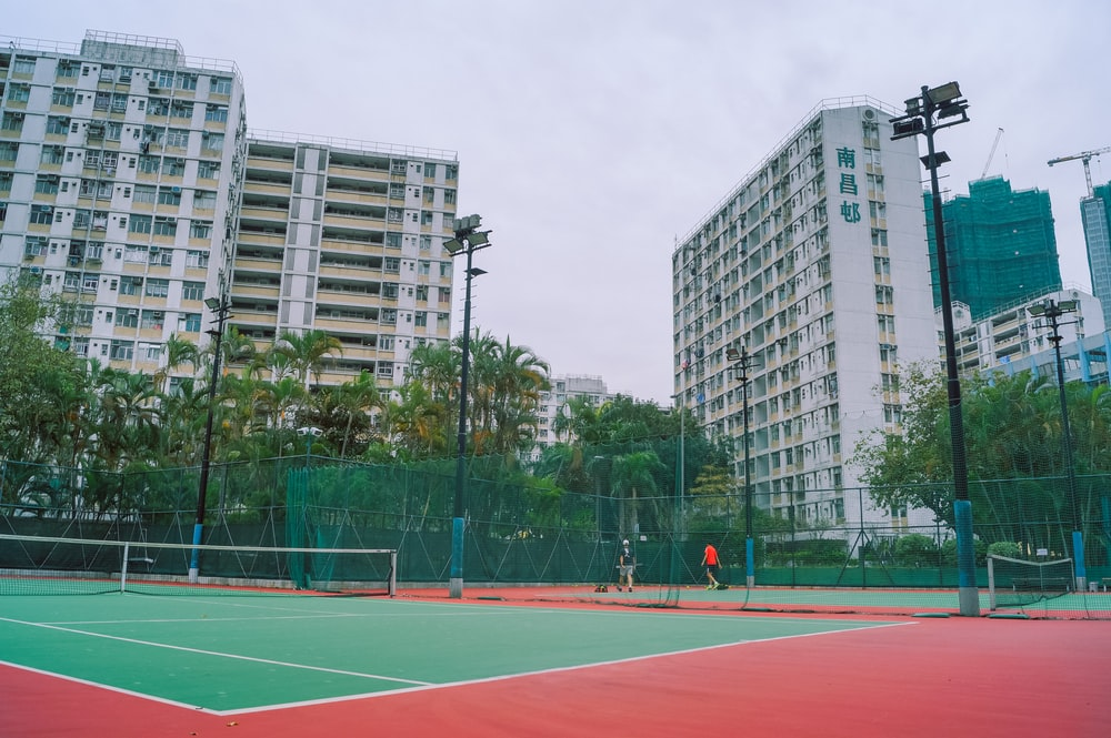 basketball court in the middle of the city during daytime