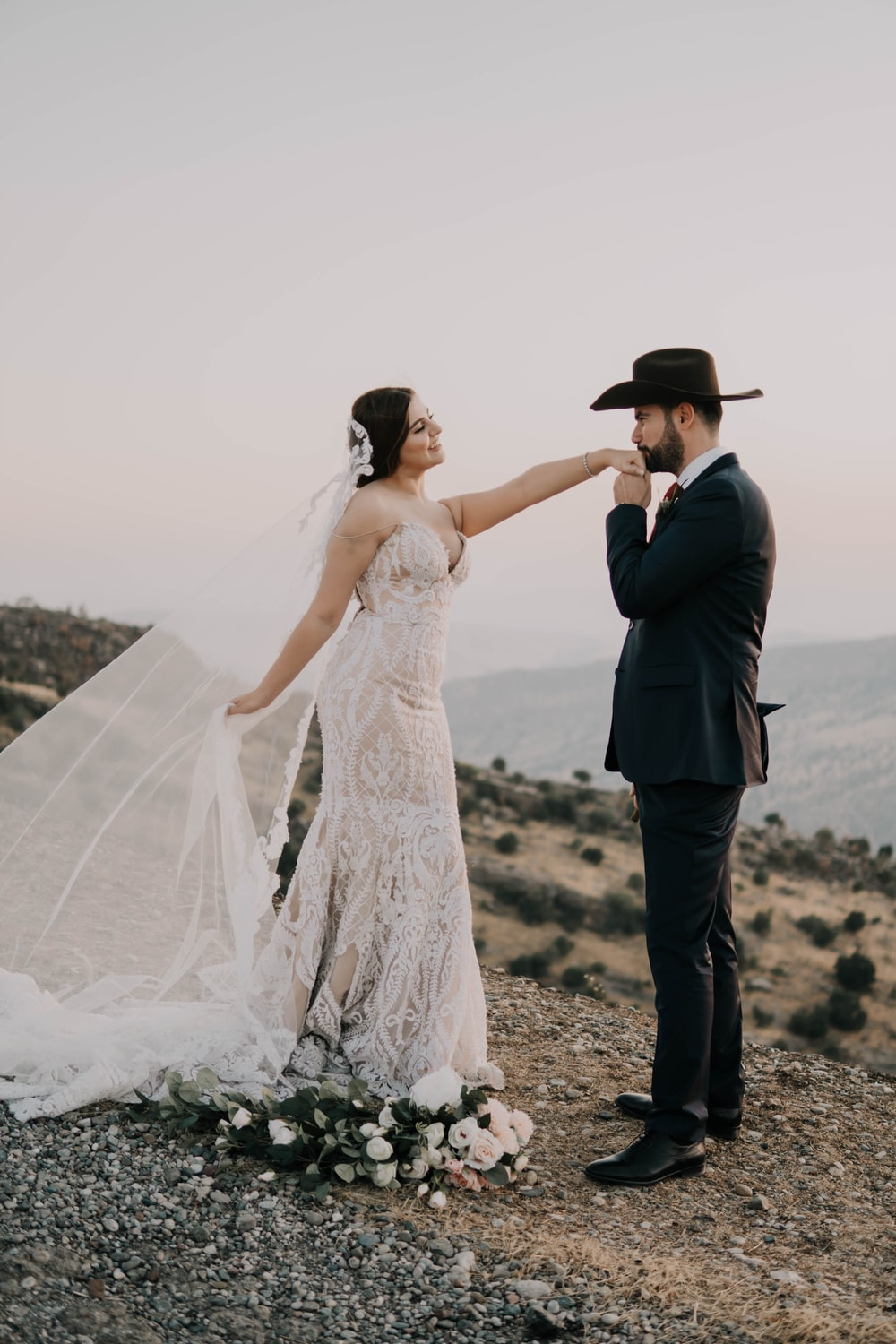 woman in white wedding dress and man in black suit
