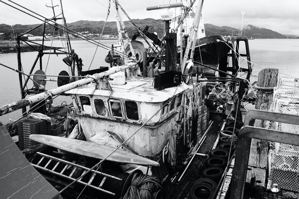 grayscale photo of fishing boat