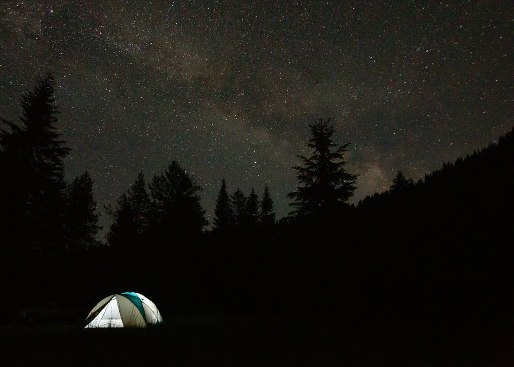 white dome tent under starry night