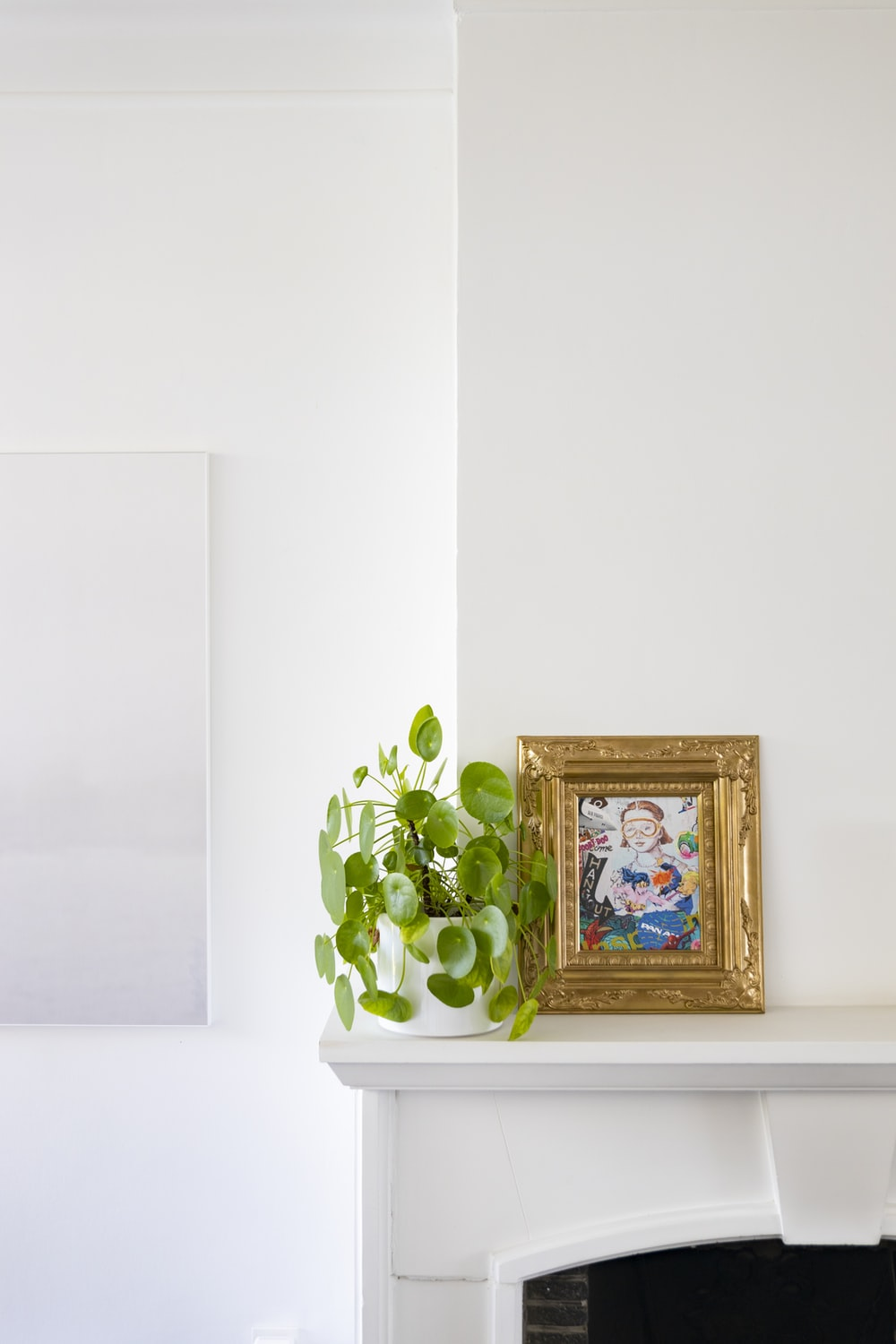 brown wooden framed picture frame on white wall